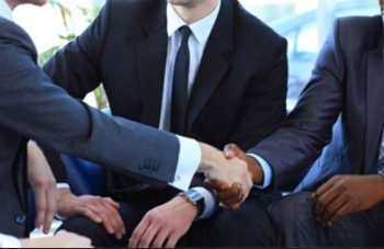 Photo of business men shaking hands