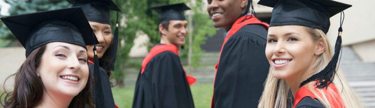 Photo of graduates in gown & caps